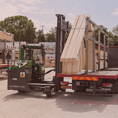 side view of attic roof trusses loaded onto trailer